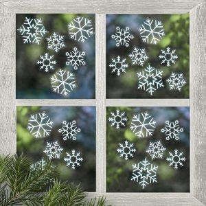 Lumihiutaletarrat ikkunaan