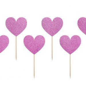 Kuppikakkukoristeet pinkeillä sydämillä